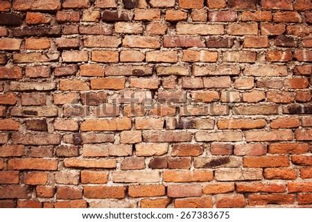 Old empty brick wall background, plaster falling off. - stock photo