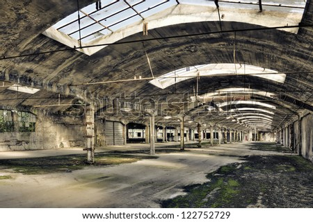 Old empty warehouse - stock photo