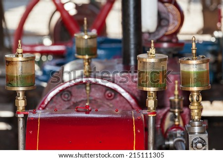 old engine brightly painted in red - stock photo