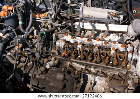 Old engine in a junkyard - stock photo