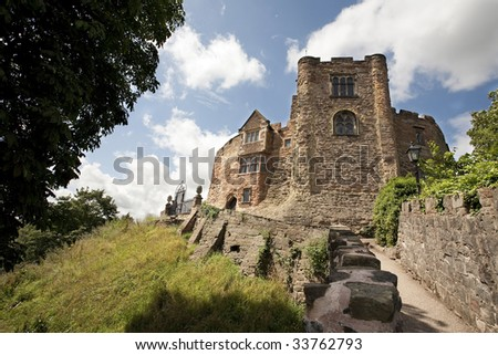 old English castle against a blue sky - stock photo
