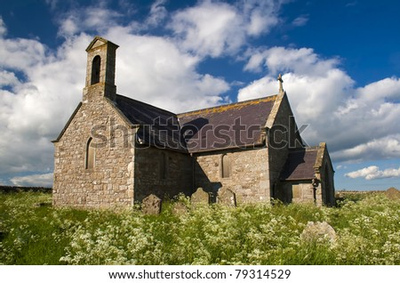 Old English Chapel with overgrown graveyard - stock photo