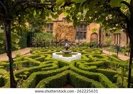 Old English Garden and Fountain  - stock photo