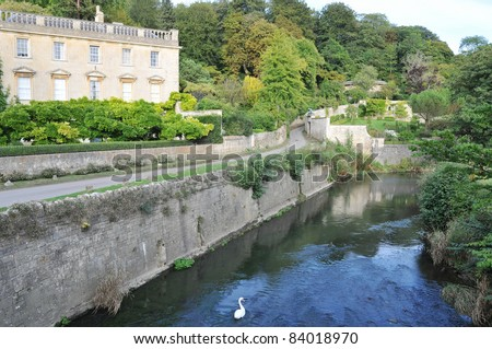 Old English Manor House on the River Frome in on the Wiltshire Somerset Border in England - stock photo
