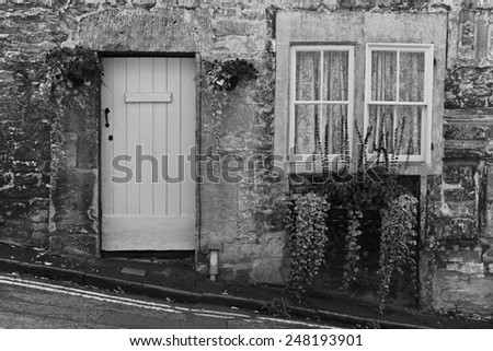 Old English Stone Cottage Exterior in Black and White - stock photo