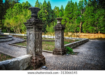 old entrance columns in Sardinia, Italy - stock photo