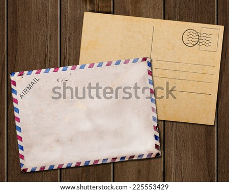Old envelope and postcard. - stock photo