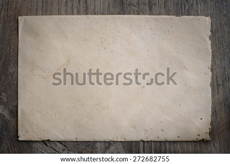 Old envelope on weathered wood texture backgrounds - stock photo