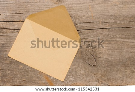 Old envelope on wooden background . With copy space - stock photo