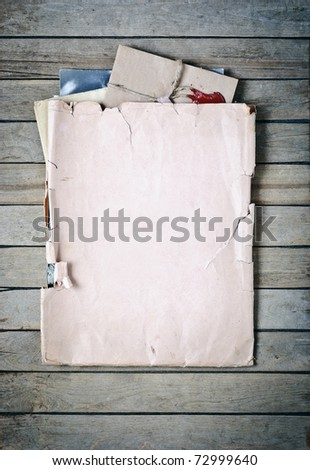 Old envelope with papers a on wooden planks background - stock photo