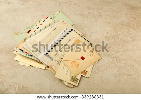 Old envelopes and letters stacked in a bundle - stock photo