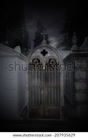 Old european cemetery chapel in a a foggy twilight - stock photo
