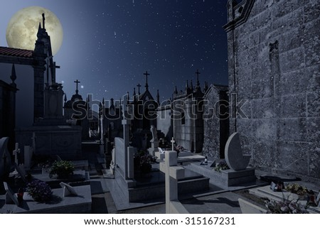 Old european cemetery in a starry full moon night  - stock photo