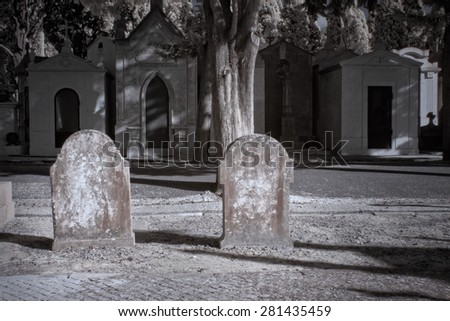 Old european cemetery tombstone. Used infrared filter. - stock photo