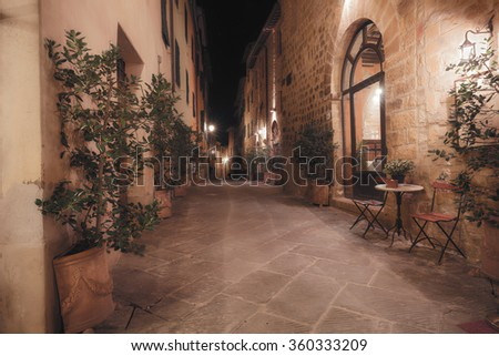 Old european city at night. Tuscany, Italy - stock photo