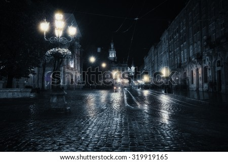 Old European city at rainy night
