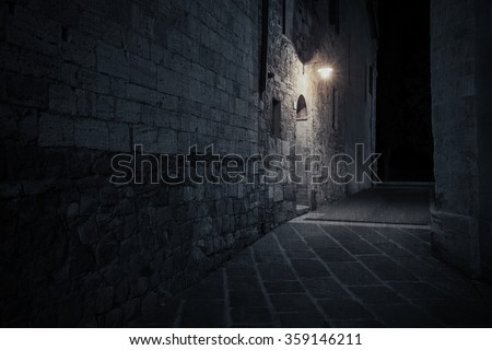 Old European street after dark at rainy night - stock photo