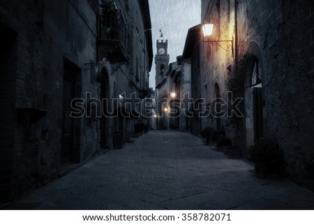Old European street after dark. Pienza, Tuscany, Italy. - stock photo