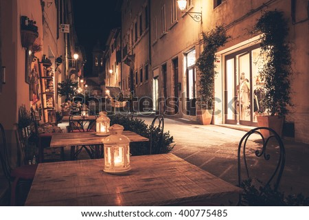 Old european town street cafe at night - stock photo