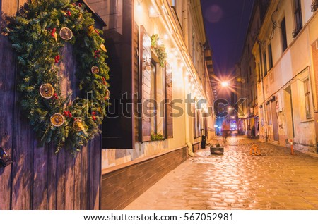 Old european town street cafe at night
