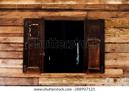 Old European wooden window with shutters
