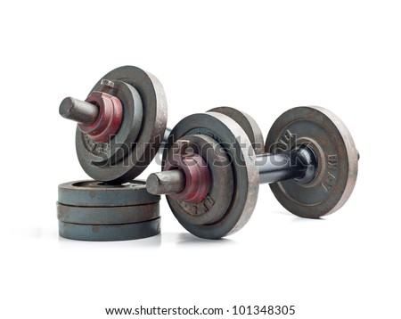 Old exercise hand weights isolated on a white background - stock photo