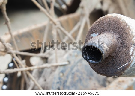 Old exhaust of the old motorcycle - stock photo