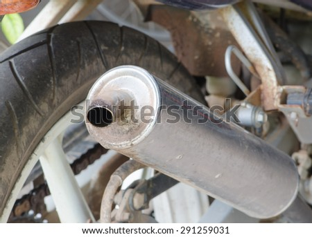 old exhaust tube of motorbike with oil stick - stock photo