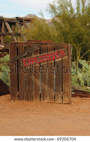 Old explosives wooden storage shed - stock photo