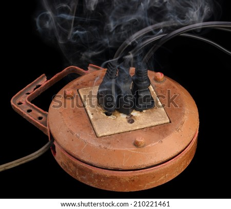 old extension sockets is connect with three plug and to have smoke - stock photo