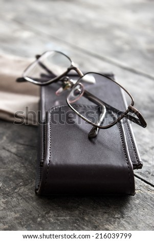 Old eyeglasses on the wooden table, close up