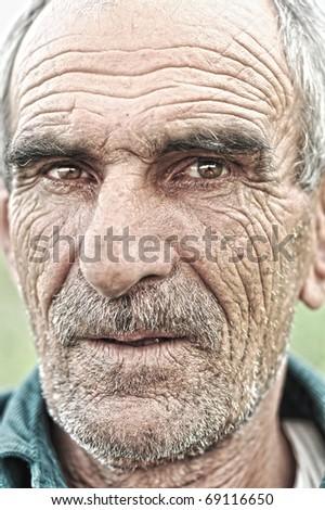 old face, elderly man, portrait outdoor - stock photo