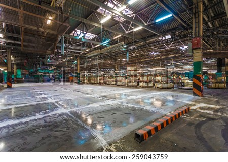Old factory for the production of car seats. Industrial space for new workshop - stock photo