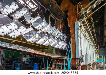 Old factory for the production of car seats. Line chemical treatment of metal - stock photo