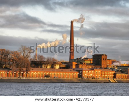 old factory on  river's bank - stock photo