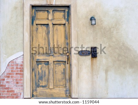 old faded door with mailbox - stock photo