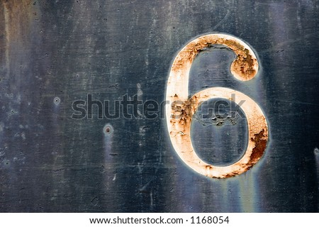 Old faded rusted cracked number six on the side of an old train car - stock photo