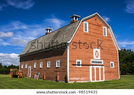 Old fading red barn on a farm - stock photo