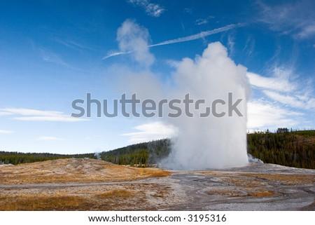 Old Faithful erupting - stock photo