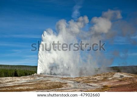Old Faithful eruption in Yellowstone National Park - stock photo