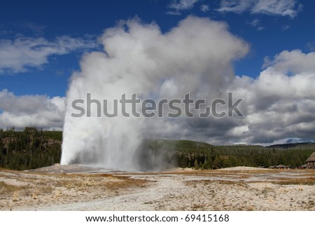 Old Faithful Geyser in Yellowstone National Park - stock photo