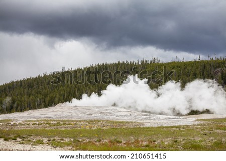 Old Faithful Geyser in Yellowstone National Park, Utah - stock photo