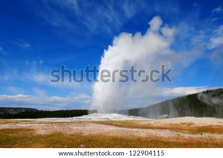 Old Faithful geyser, Yellowstone NP - stock photo