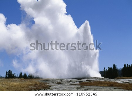 Old Faithful in Yellowstone National Park, Wyoming, USA - stock photo