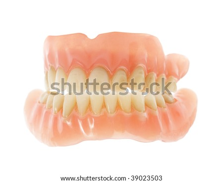Old false teeth isolated on white