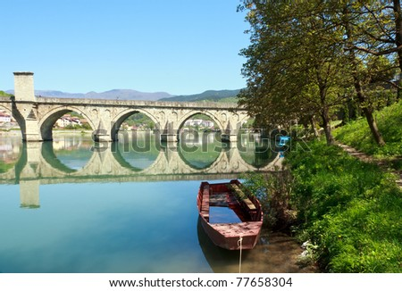 Old,Famous bridge on the Drina in Visegrad, Bosnia and Herzegovina, on a hot summer day. - stock photo