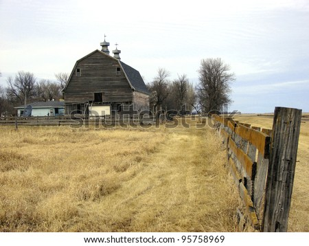 old farm building and wooden fence - stock photo