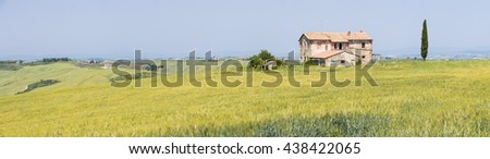 old farm building in panoramic view in Tuscany in Italy - stock photo