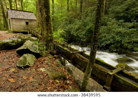Old farm by the stream in Smoky Mountains - stock photo
