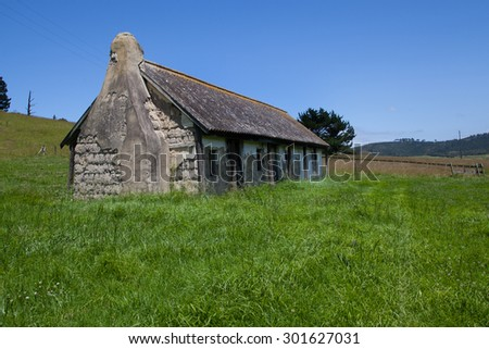 Old farm house build with mud bricks and a tin roof.
